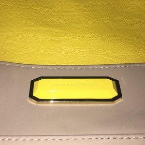 Brown and yellow wristbag VS
